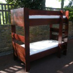 Softwood bunkbed with rosewood stain which can be detached to make two single beds. West Dulwich SE21
