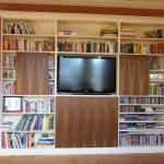 Bookcase unit with sliding walnut veneer doors. Forest Hill SE23