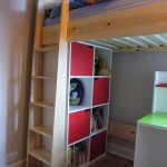 Raised level child's bed with shelving and desk below. Crouch End